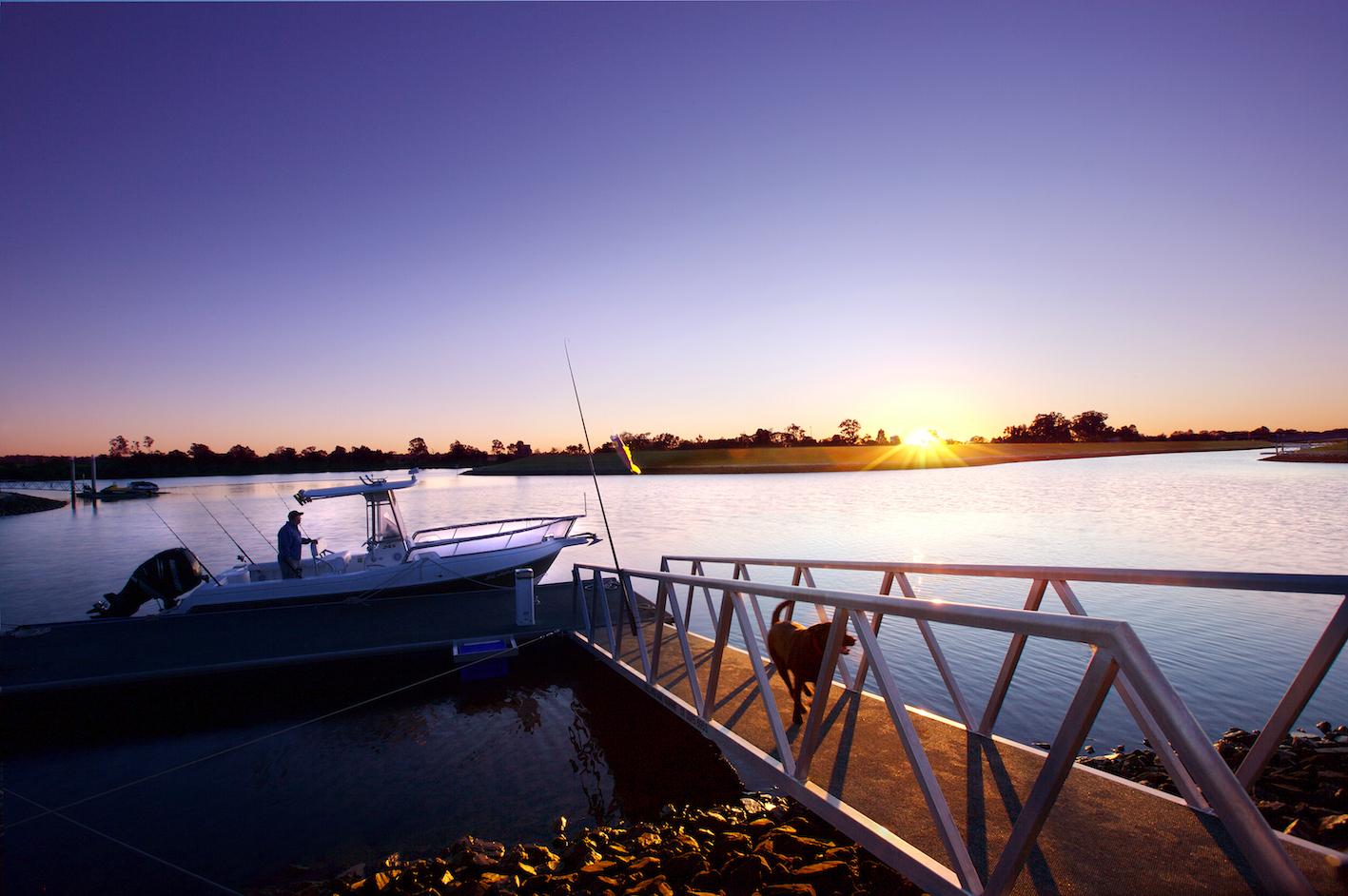 Man, boat, dog, pontoon